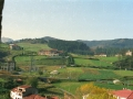 Vista de prados, sembrados y casas de Oñati desde el campanario de la iglesia parroquial de San Miguel